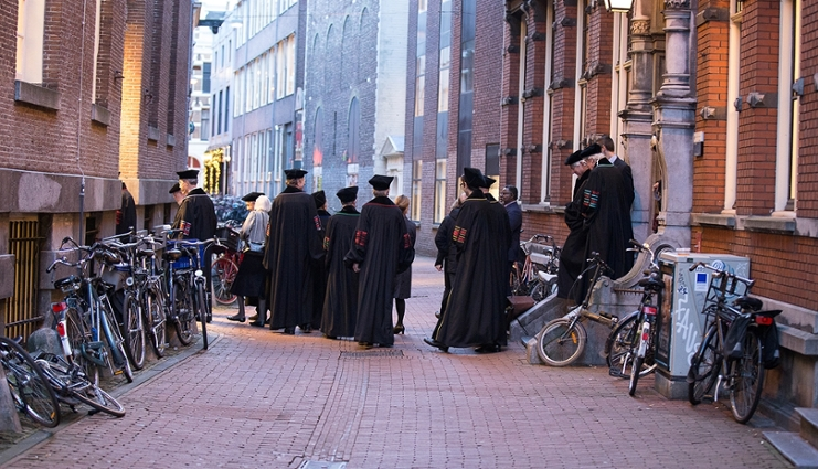 Professors making the way from the Aula to the Maagdenhuis on the University's bithday.